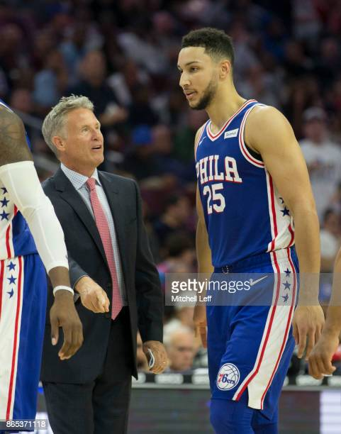 Head coach Brett Brown of the Philadelphia 76ers talks to Ben Simmons during a timeout against the Boston Celtics at the Wells Fargo Center on...