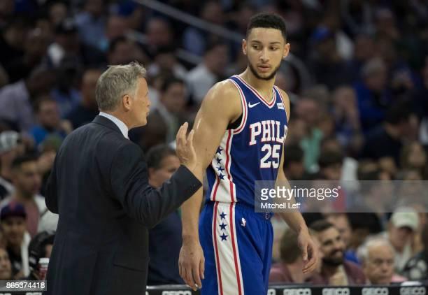 Head coach Brett Brown of the Philadelphia 76ers talks to Ben Simmons against the Boston Celtics at the Wells Fargo Center on October 20 2017 in...