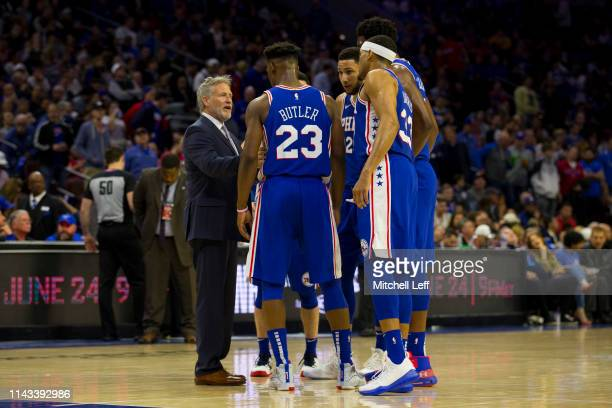 Head coach Brett Brown of the Philadelphia 76ers talks to Jimmy Butler Tobias Harris Ben Simmons and Joel Embiid against the Brooklyn Nets in Game...