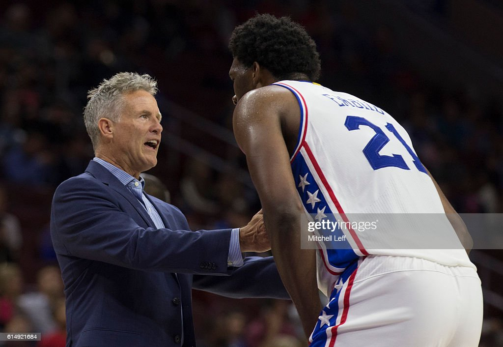 Head coach Brett Brown of the Philadelphia 76ers talks to Joel Embiid #21 during a timeout against the Detroit Pistons in the second half at Wells Fargo Center on October 15, 2016 in Philadelphia, Pennsylvania. The Pistons defeated the 76ers 97-76.