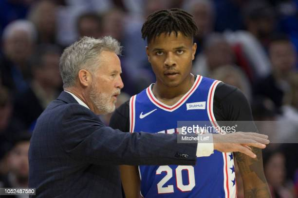 Head coach Brett Brown of the Philadelphia 76ers talks to Markelle Fultz in the first quarter against the Chicago Bulls at Wells Fargo Center on...