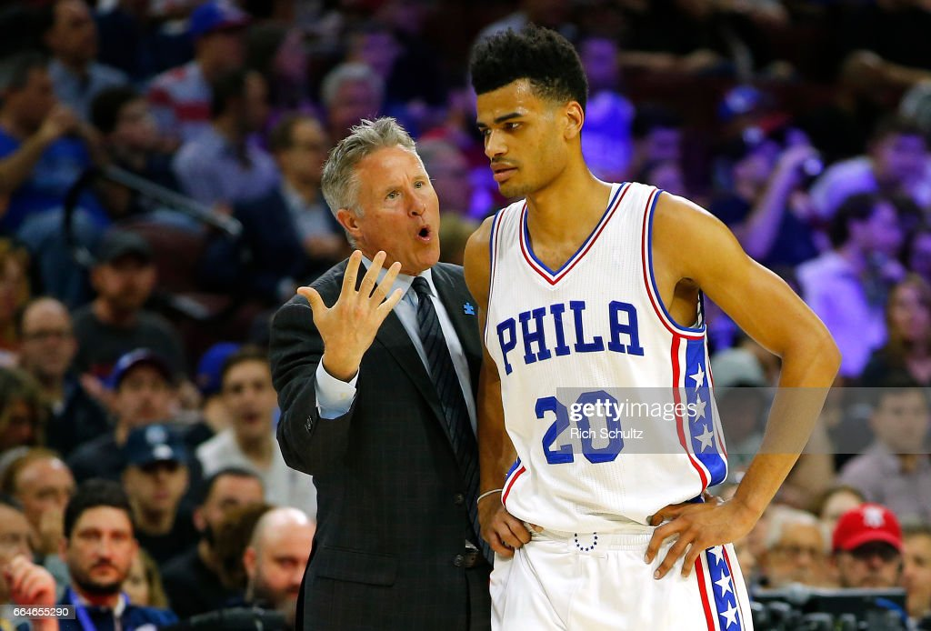 Head coach Brett Brown of the Philadelphia 76ers talks with Timothe Luwawu-Cabarrot #20 in the first half during an NBA game against the Brooklyn Nets at Wells Fargo Center on April 4, 2017 in Philadelphia, Pennsylvania. The Nets defeated 76ers 141-118.NOTE