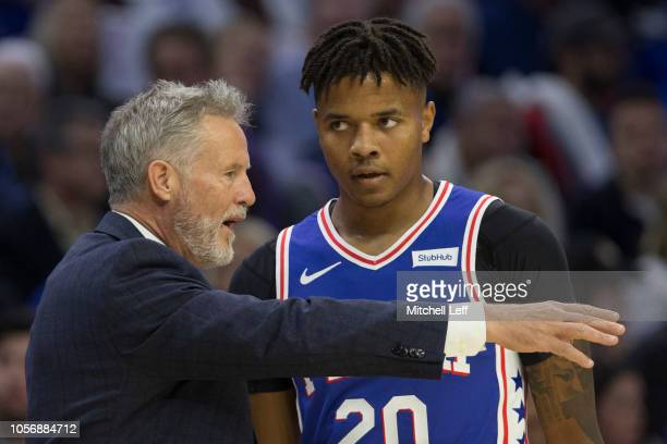 Head coach Brett Brown talks to Markelle Fultz of the Philadelphia 76ers against the Chicago Bulls at the Wells Fargo Center on October 18 2018 in...