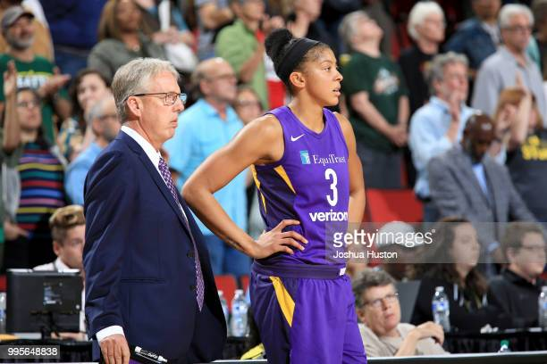 Head Coach Brian Agler and Candace Parker of the Los Angeles Sparks look on during the game against the Seattle Storm on July 10 2018 at Key Arena in...