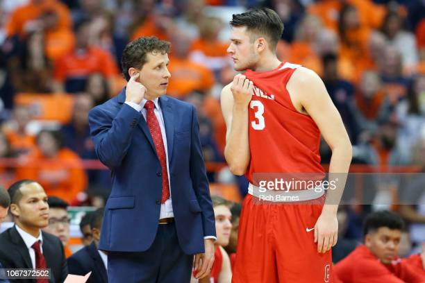 Head coach Brian Earl of the Cornell Big Red talks with Jimmy Boeheim against the Syracuse Orange during the second half at the Carrier Dome on...
