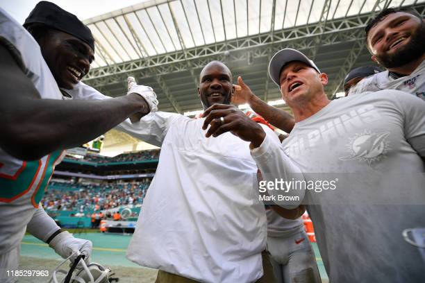 Head Coach Brian Flores of the Miami Dolphins celebrates his first victory against the New York Jets in the first quarter at Hard Rock Stadium on...