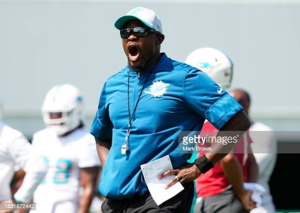 Head Coach Brian Flores of the Miami Dolphins yells out instructions during Training Camp at Baptist Health Training Complex on July 31, 2021 in...