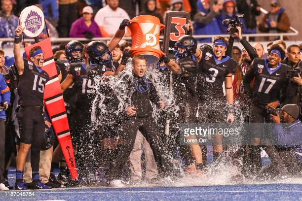 Head Coach Brian Harsin of the Boise State Broncos is doused in gatorade during second half action in the Mountain West Championship against the...