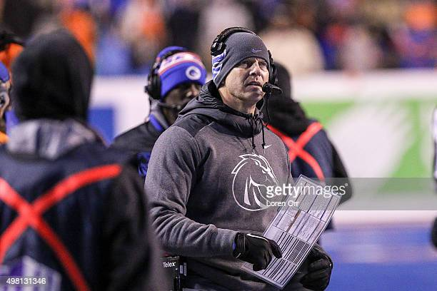 Head coach Brian Harsin of the Boise State Broncos looks to the instant replay display during second half action against the Air Force Falcons on...
