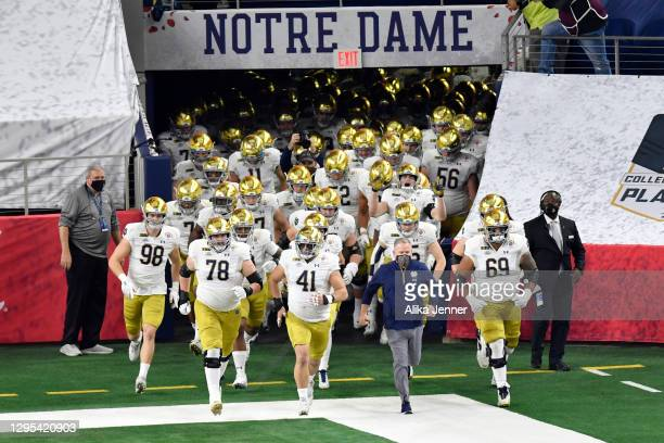 Head coach Brian Kelly and the Notre Dame Fighting Irish football players run on the field during player introductions before the College Football...