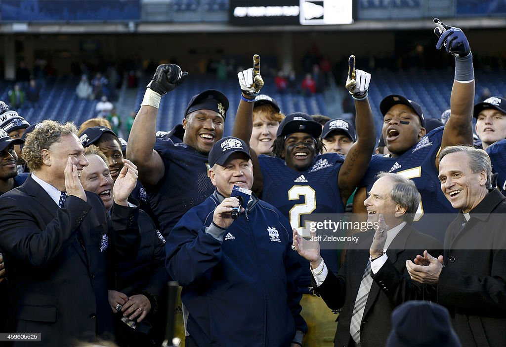 Head coach Brian Kelly of the Notre Dame Fighting Irish celebrates winning against the Rutgers Scarlet Knights in the New Era Pinstripe Bowl at Yankee Stadium on December 28, 2013 in the Bronx borough of New York City.