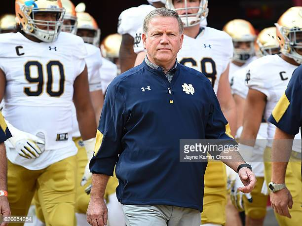 Head coach Brian Kelly of the Notre Dame Fighting Irish leads his team on to the field for the game against the USC Trojans at the Los Angeles...