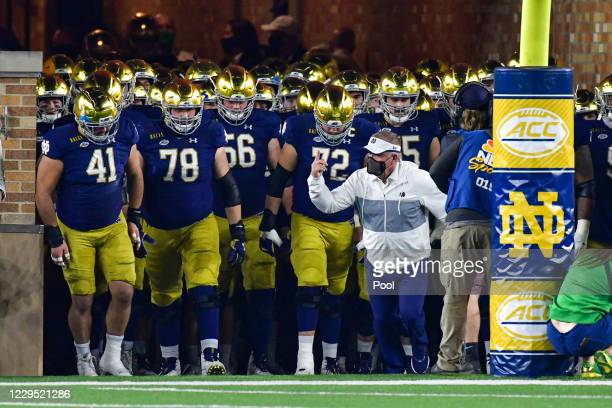 Head coach Brian Kelly of the Notre Dame Fighting Irish leads his team out of the tunnel before the game against the Clemson Tigers at Notre Dame...
