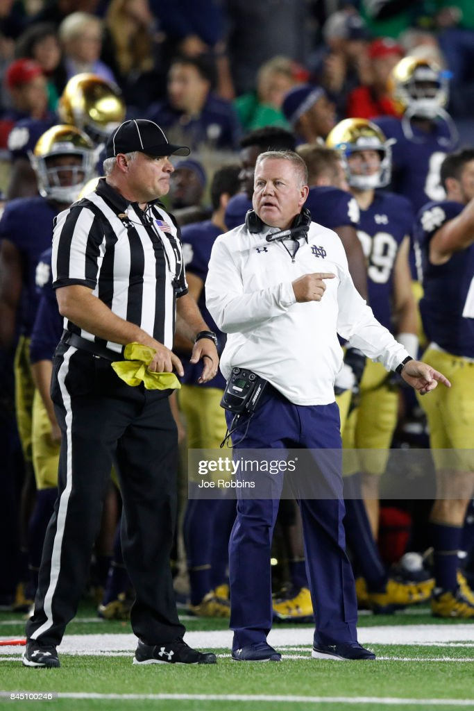 Head coach Brian Kelly of the Notre Dame Fighting Irish questions an official in the third quarter of a game against the Georgia Bulldogs at Notre Dame Stadium on September 9, 2017 in South Bend, Indiana. Georgia won 20-19.