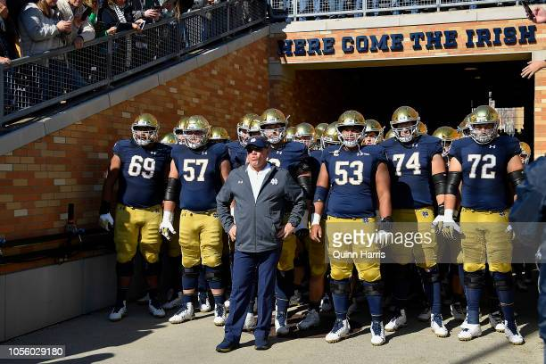Head coach Brian Kelly of the Notre Dame Fighting Irish stands in the tunnel in front of his team before the game against the Pittsburgh Panthers at...