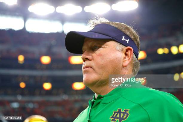 Head coach Brian Kelly of the Notre Dame Fighting Irish takes the field with his team before the game against the Clemson Tigers during the College...