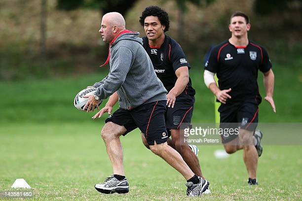 Head coach Brian McClennan runs through drills during a New Zealand Warriors NRL training session at Otahuhu College on April 30 2012 in Auckland New...