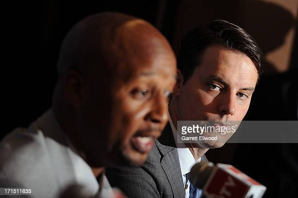 Head Coach Brian Shaw answers questions from the media as President Josh Kroenke of the Denver Nuggets looks on during the press conference on June...