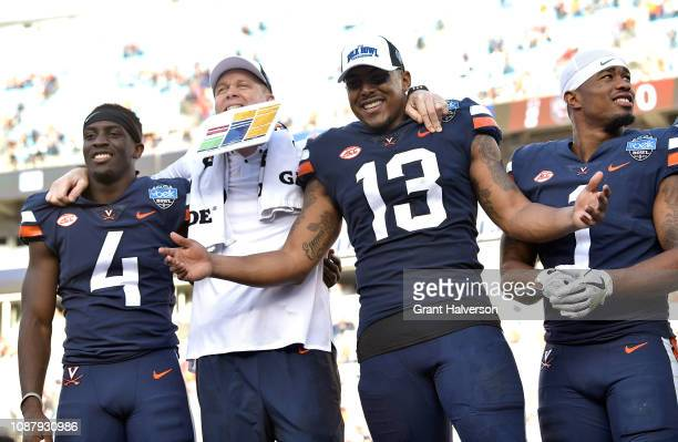Head coach Bronco Mendenhall of the Virginia Cavaliers celebrates with his team after a win against the South Carolina Gamecocks during the Belk Bowl...