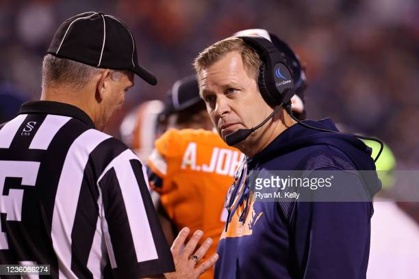 Head coach Bronco Mendenhall of the Virginia Cavaliers speaks to an umpire about a penalty in the second half during a game against the Georgia Tech...