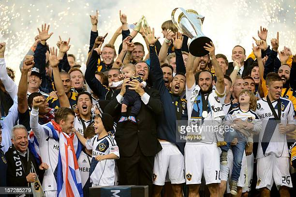 Head coach Bruce Arena and Landon Donovan of Los Angeles Galaxy celebrate the 31 victory against the Houston Dynamo to win the 2012 MLS Cup at The...