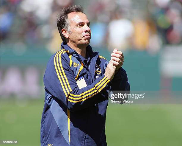 Head Coach Bruce Arena of the Los Angeles Galaxy celebrates after the final whistle is blown after the game between the Los Angeles Galaxy and DC...