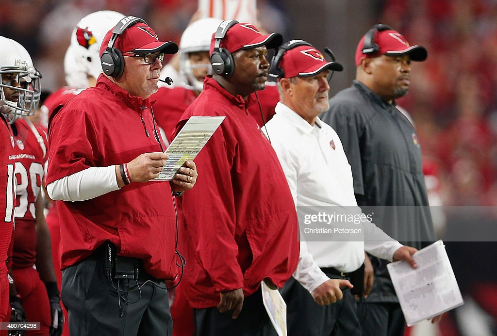 Head coach Bruce Arians, defensive coordinator Todd Bowles, strength and conditioning coach Buddy Morris and offensive coordinator Harold Goodwin of the Arizona Cardinals on the sidelines during the NFL game against the Kansas City Chiefs at the University of Phoenix Stadium on December 7, 2014 in Glendale, Arizona. The Cardinals defeated the Chiefs 17-14.