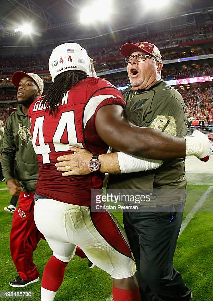 Head coach Bruce Arians of the Arizona Cardinals celebrates with outside linebacker Markus Golden after defeating the Cincinnati Bengals in the NFL...