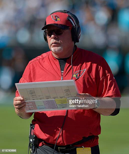 Head coach Bruce Arians of the Arizona Cardinals directs his team against the Carolina Panthers during the game at Bank of America Stadium on October...