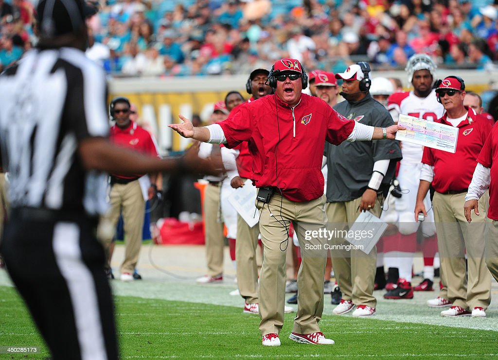 Head Coach Bruce Arians of the Arizona Cardinals disputes a call with an official during the game against the Jacksonville Jaguars at EverBank Field on November 17, 2013 in Jacksonville, Florida.