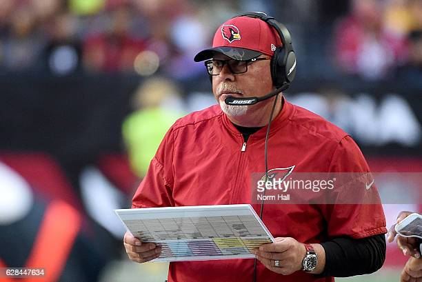Head coach Bruce Arians of the Arizona Cardinals looks at his play chart while standing on the sidelines during a game against the Washington...