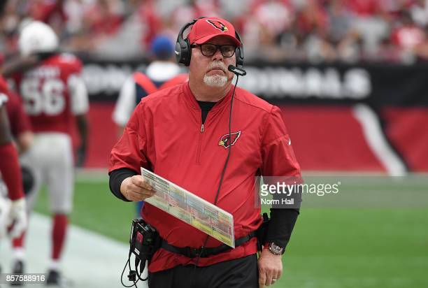 Head coach Bruce Arians of the Arizona Cardinals looks on from the sidelines while holding his play chart during a game against the San Francisco...