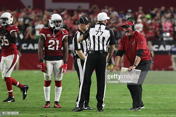 Head coach Bruce Arians of the Arizona Cardinals reacts to referee Terry McAulay during the NFL game against the Seattle Seahawks at the University...
