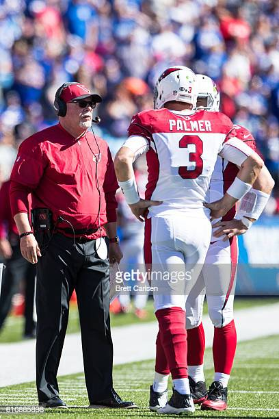 Head coach Bruce Arians of the Arizona Cardinals speaks with Carson Palmer during the game against the Buffalo Bills on September 25 2016 at New Era...