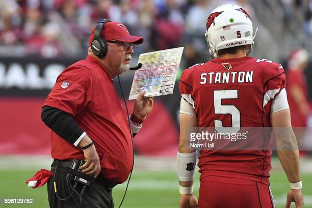 Head coach Bruce Arians of the Arizona Cardinals talks with quarterback Drew Stanton in the first half of the NFL game against the New York Giants at...