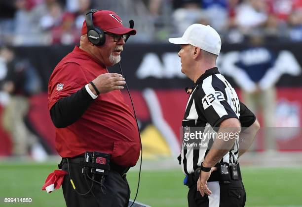 Head coach Bruce Arians of the Arizona Cardinals talks with referee John Parry during a game against the New York Giants at University of Phoenix...