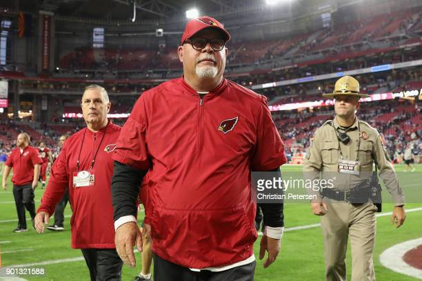 Head coach Bruce Arians of the Arizona Cardinals walks off the field following the NFL game against the New York Giants at the University of Phoenix...