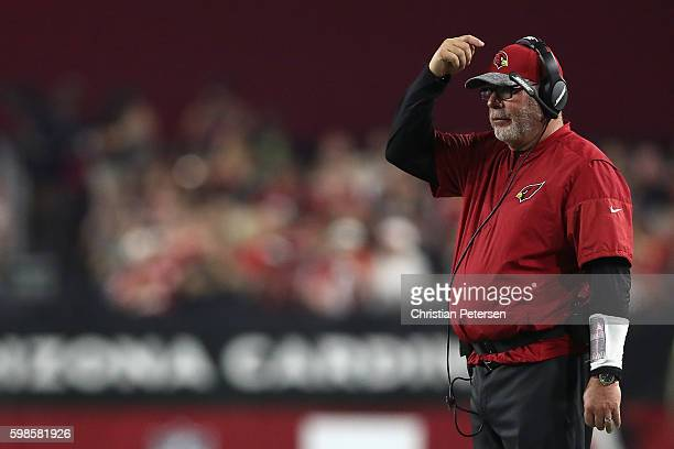Head coach Bruce Arians of the Arizona Cardinals watches from the sidelines during the preseaon NFL game against the Denver Broncos at the University...