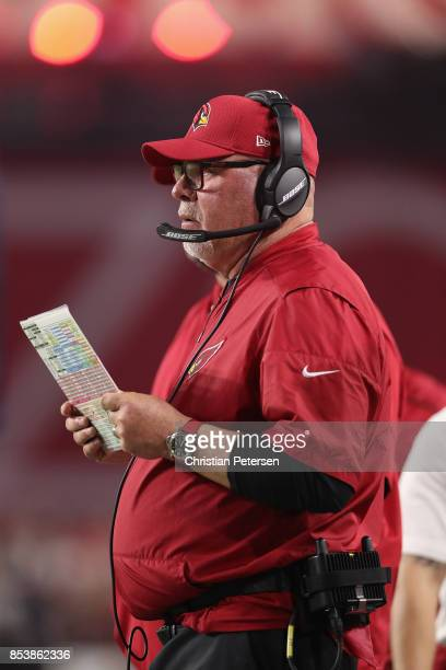 Head coach Bruce Arians of the Arizona Cardinals watches the action during the first half of the NFL game against the Dallas Cowboys at the...