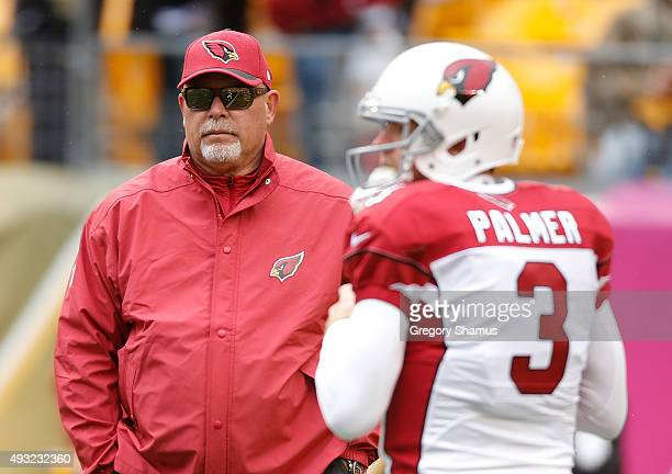 Head Coach Bruce Arians of the of the Arizona Cardinals and Carson Palmer look on before the game against the Pittsburgh Steelers at Heinz Field on...