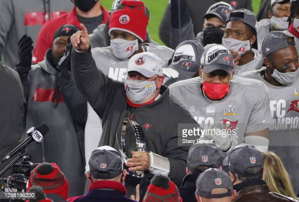Head coach Bruce Arians of the Tampa Bay Buccaneers celebrates with his team team after their 31 to 26 win over the Green Bay Packers during the NFC...