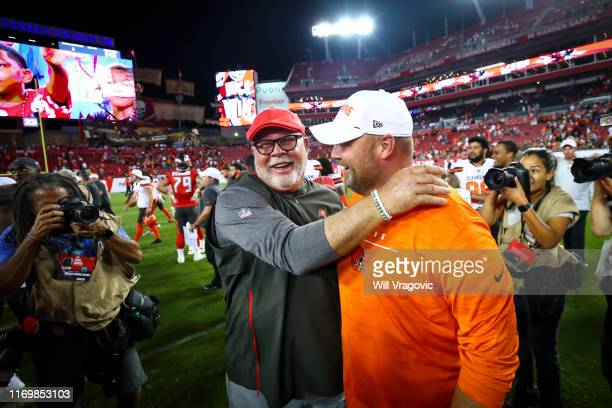 Head coach Bruce Arians of the Tampa Bay Buccaneers hugs head coach Freddie Kitchens of the Cleveland Browns after the preseason game at Raymond...