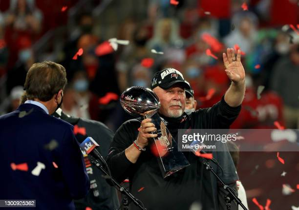 Head coach Bruce Arians of the Tampa Bay Buccaneers lifts the Lombardi Trophy after defeating the Kansas City Chiefs in Super Bowl LV at Raymond...