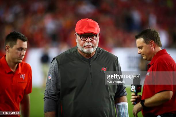 Head coach Bruce Arians of the Tampa Bay Buccaneers walks off the field at halftime of the preseason game against the Cleveland Browns at Raymond...
