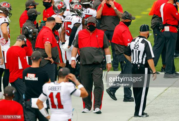 Head coach Bruce Arians of the Tampa Bay Buccaneers walks on the sideline during the first half against the Carolina Panthers at Raymond James...