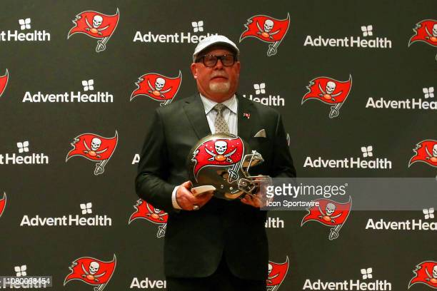 Head Coach Bruce Arians poses with the team helmet after the introductory press conference for new Tampa Bay Buccaneers Head Coach Bruce Arians on...