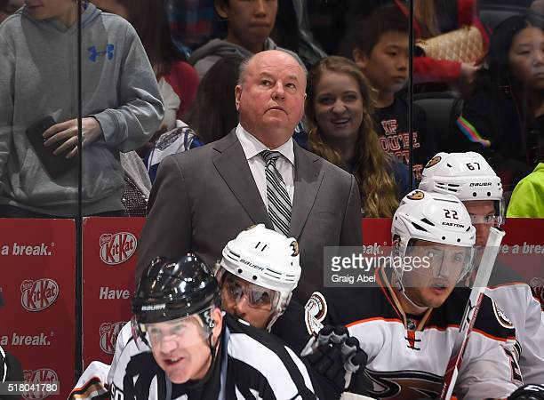 Head Coach Bruce Boudreau of the Anaheim Ducks checks out the time remaining during game action against the Toronto Maple Leafs on March 24 2016 at...