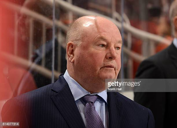 Head coach Bruce Boudreau of the Anaheim Ducks looks on from the bench against the Arizona Coyotes at Gila River Arena on March 3 2016 in Glendale...