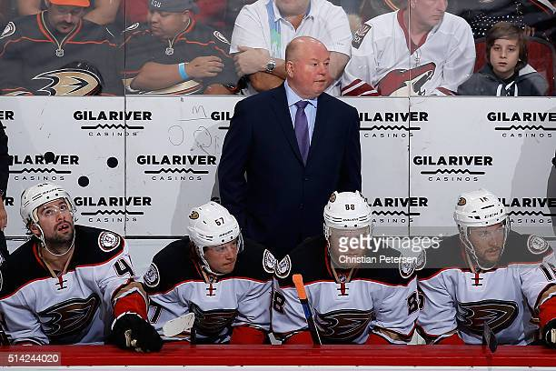 Head coach Bruce Boudreau of the Anaheim Ducks on the bench during the NHL game against the Arizona Coyotes at Gila River Arena on March 3 2016 in...
