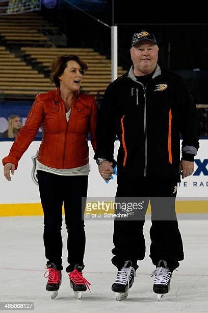 Head coach Bruce Boudreau of the Anaheim Ducks skates with his wife Crystal during the family skate following team practice for the 2014 Coors Light...